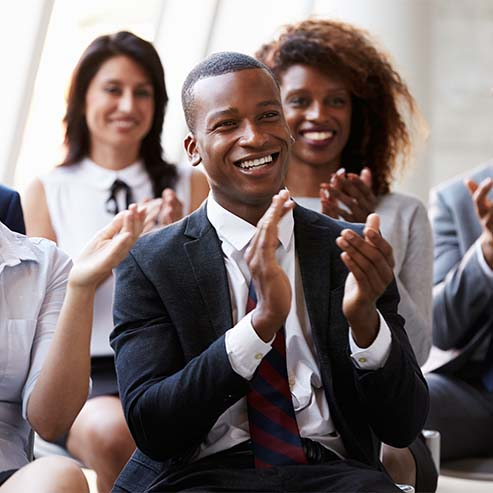 Crowd of Business People Clapping and Smiling, You Black Man in the Foreground